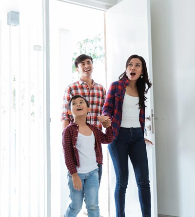 family obviously in love with their dream home