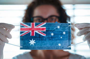 Woman showing COVID-19 surgical mask with Australian flag